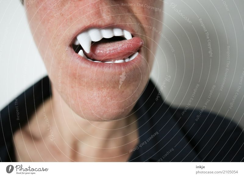 Close-up of a female mouth with vampire teeth and tongue Carnival Hallowe'en Mouth Teeth Tongue 1 Human being To enjoy Threat Desire Thirst Creepy False