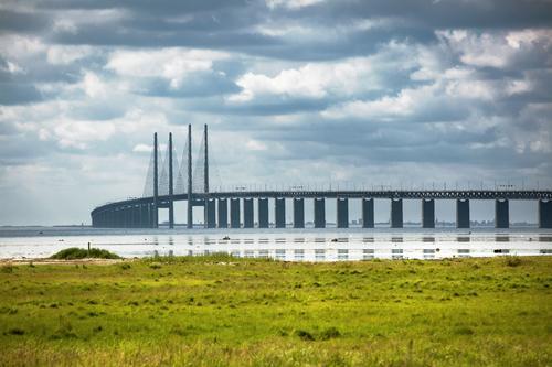 Öresund bridge near Malmö Clouds Summer Meadow Coast Baltic Sea Sweden Bridge Tourist Attraction Oeresund bridge Transport Traffic infrastructure Esthetic