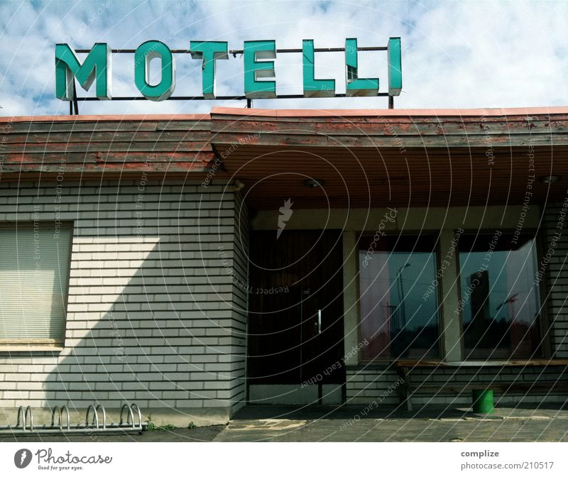 What's motel in Finnish? Vacation & Travel Tourism Summer Services Outskirts built Hotel Characters Signs and labeling Derelict Empty Motel Boarding house