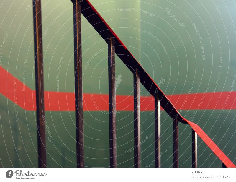 Railing in front of green wall with red stripe Design Stairs Handrail Colour photo Interior shot Red Canceled Line Banister Metal Structures and shapes Deserted
