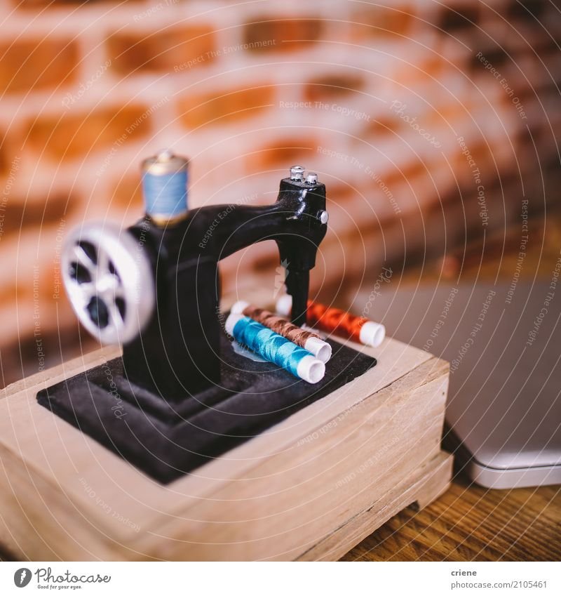 Close-up of miniature sewing machine Lifestyle Design Leisure and hobbies Interior design Decoration Work and employment Profession Workplace Office