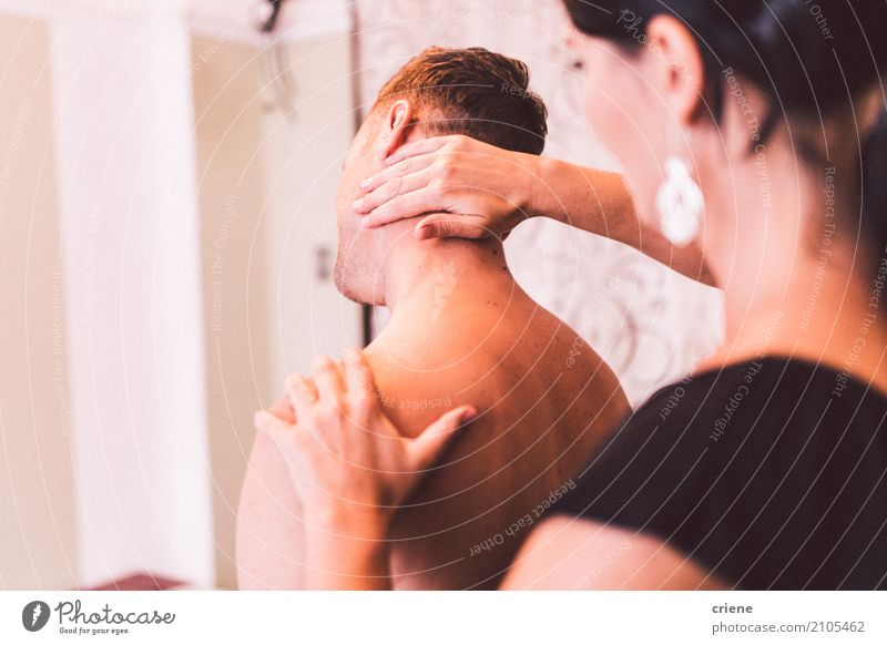 Physiotherapist giving neck massage to patient Human being Woman Man Adults Life Lifestyle Healthy Feminine Health care Work and employment Masculine Body Skin