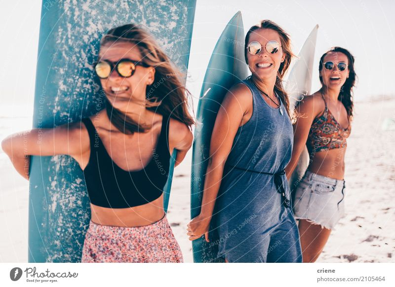 Group of young woman having fun at the beach with surfboards Human being Woman Vacation & Travel Youth (Young adults) Young woman Summer Sun Relaxation Joy