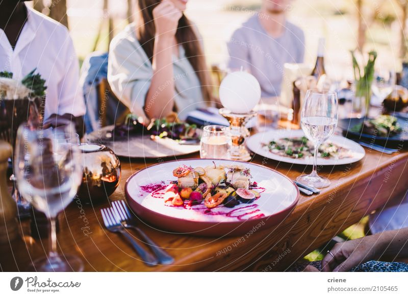 Group Of People Enjoying Food And Wine At Restaurant Human Being Summer Eating Life Lifestyle Family