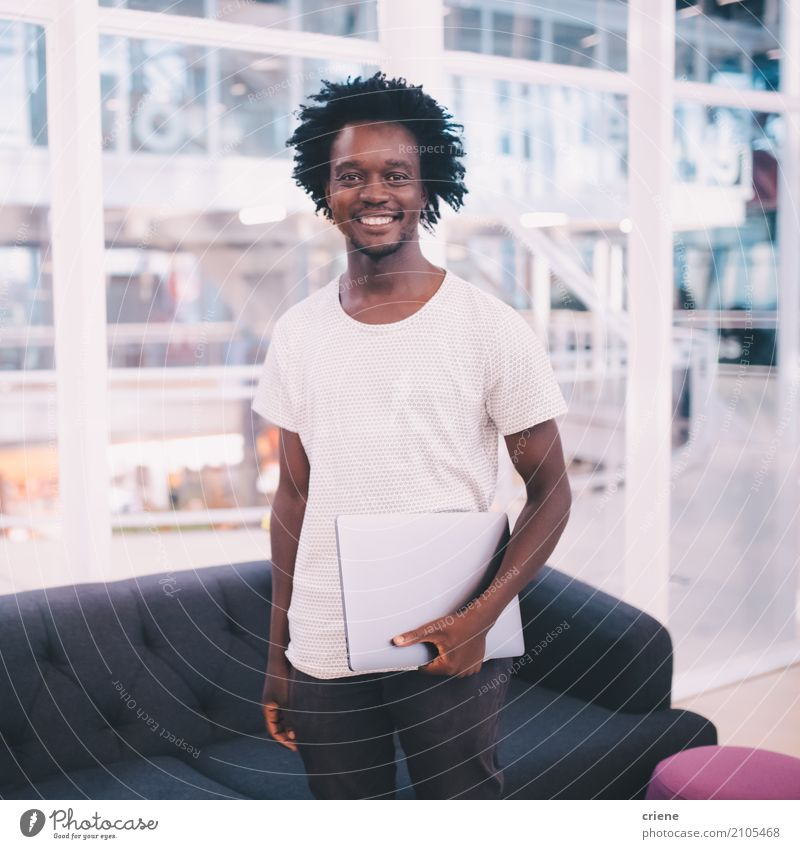 Portrait of young african businessman in the office Human being Youth (Young adults) Young man Joy 18 - 30 years Adults Lifestyle Business Work and employment Masculine Office Modern Technology Success Smiling Driving