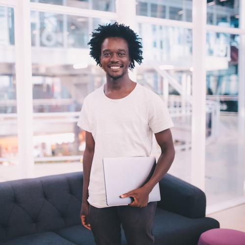 Portrait of young african businessman in the office Lifestyle Joy Work and employment Profession Workplace Office Business SME Career Success Notebook