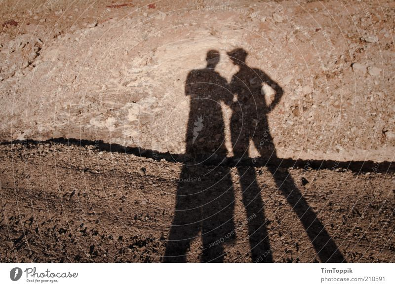 Human being Red Couple Lanes & trails Together Empty Gloomy Desert Dry Shadow Drought Sparse Stony Shadow play Lanzarote