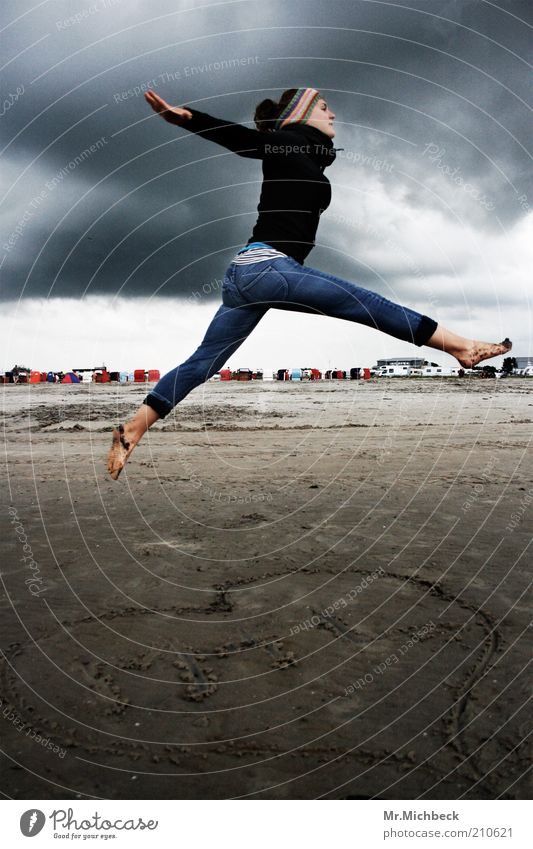 Woman Human being Youth (Young adults) Beach Clouds Life Dark Cold Feminine Jump Movement Gray Sand Air Contentment