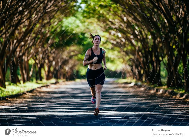 Running in the park Athletic Summer Fitness Sports Training Track and Field Jogging Masculine Woman Adults 1 Human being 18 - 30 years Youth (Young adults)