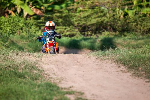 Motocross Human being Child Youth (Young adults) Green Tree Street Sports Grass Boy (child) Earth Infancy Cute Virgin forest Self-confident Track Racecourse