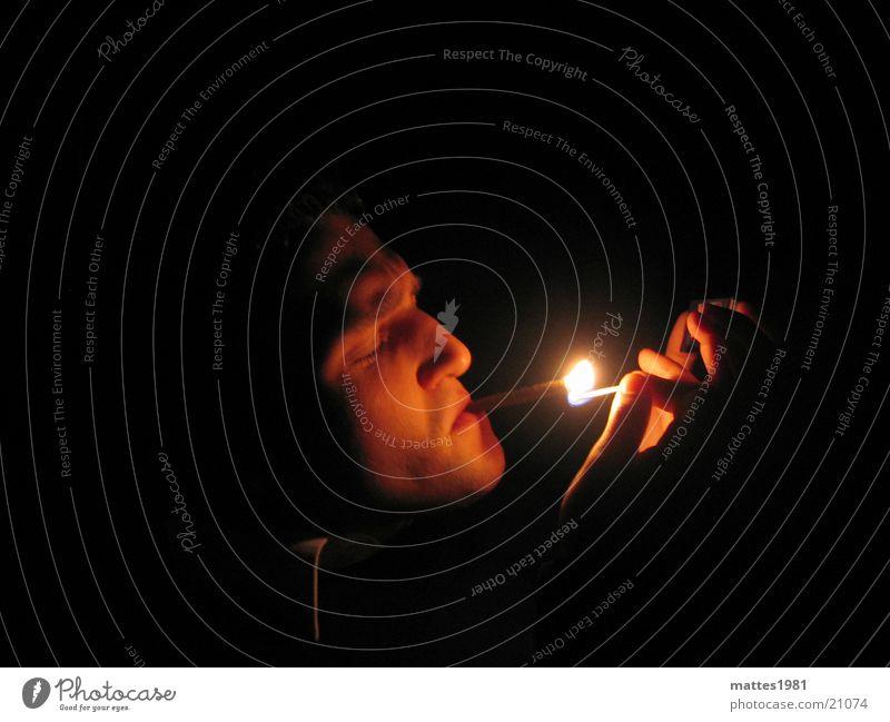 Man Calm Warmth Smoking To enjoy Snapshot Match Ignite Face of a man Inhale Harmful to health Dark background Health hazard