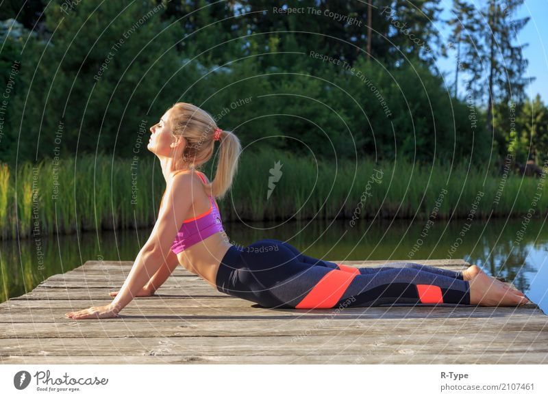 A sporty woman doing yoga and stretching exercises Lifestyle Wellness Sports Yoga Human being Woman Adults Nature Park Fashion Blonde Fitness aerobics active