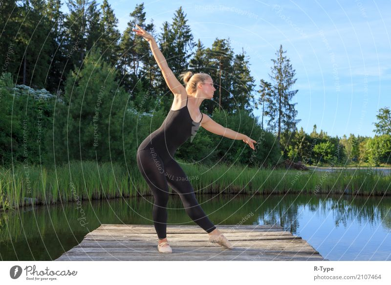 A pretty dancer dancing on a pear Lifestyle Elegant Style Sports Dance Woman Adults Artist Nature Park Fashion Blonde Fitness aerobics acrobat Action active