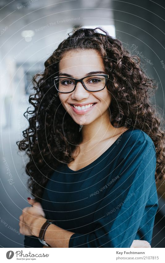 Business portrait young woman with curly hair and glasses Elegant Style Joy Happy Beautiful Personal hygiene Hair and hairstyles Face Wellness Harmonious