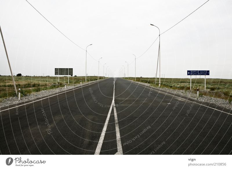 Far-off places Street Cold Horizon Future Gloomy Asia Asphalt Infinity Street lighting Steppe Lamp post Right ahead Vanishing point Border area Median strip