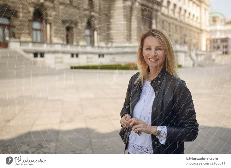 Attractive woman standing in an urban square Human being Woman Face Adults Building Happy Copy Space Blonde Stand Smiling Historic Tourist Palace Middle-aged