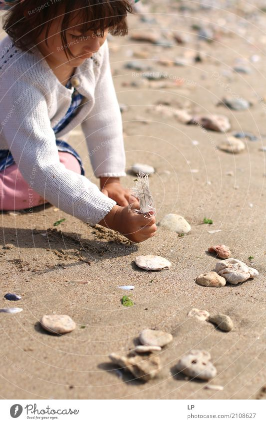 writing on the sand Human being Child Vacation & Travel Ocean Relaxation Calm Beach Life Emotions Playing Stone Leisure and hobbies Trip Contentment Infancy