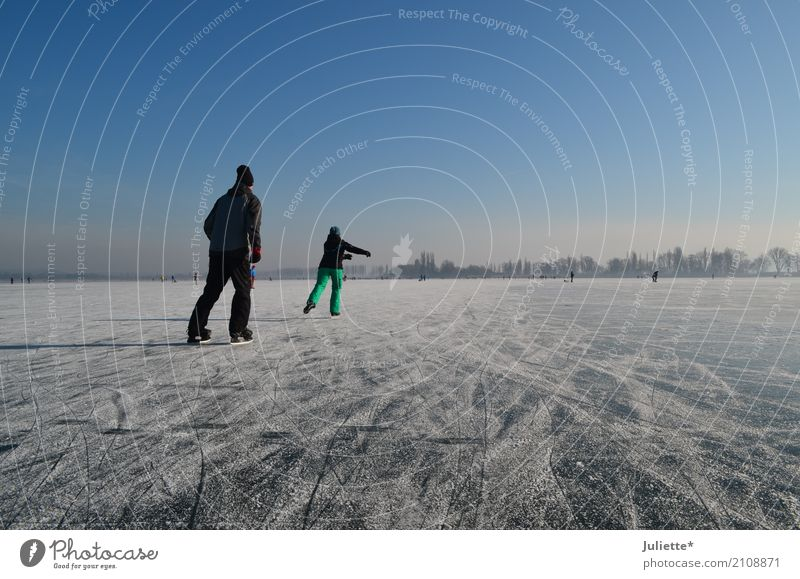 on ice Vacation & Travel Trip Adventure Winter Sports Ice-skating Ice-skates Human being Masculine Feminine Woman Adults Man Friendship Couple 2 30 - 45 years