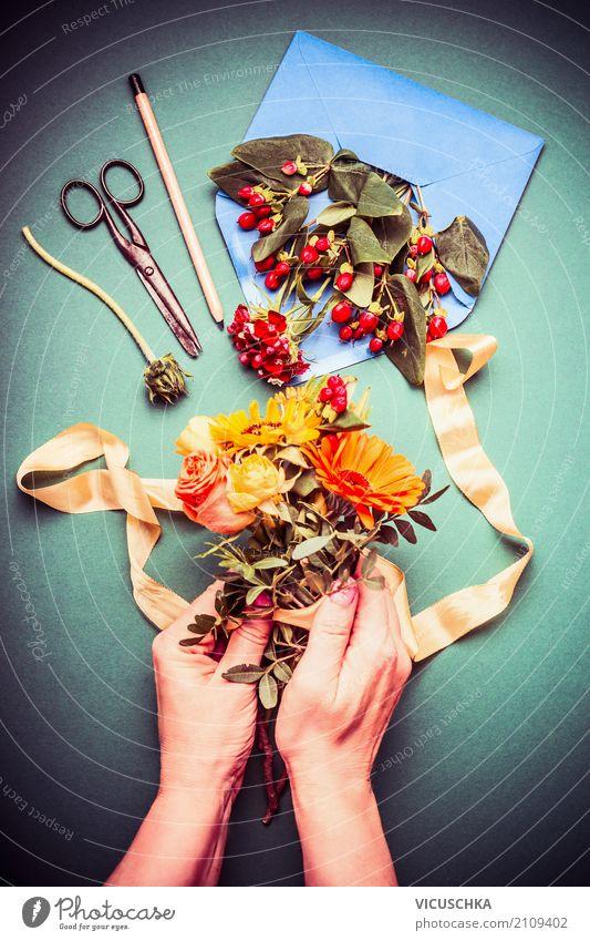 Female hands make an autumn bouquet Lifestyle Elegant Style Decoration Feasts & Celebrations Feminine Hand Nature Plant Rose Bouquet Yellow Pink Design Arranged