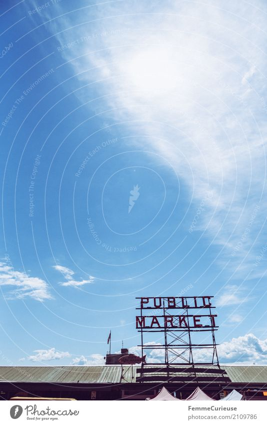 Roadtrip West Coast USA (261) Town Shopping Covered market Market day Markets public market Seattle Summer Sunbeam Roof Signage Characters Blue sky Clouds