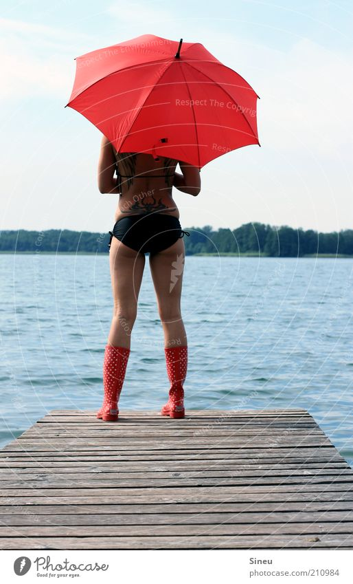 The water was way too deep. Tourism Far-off places Summer vacation Feminine Woman Adults Sky Beautiful weather Lake Bikini Umbrella Rubber boots Observe