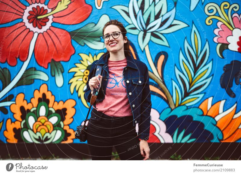 Young woman in front of colorful graffiti wall Feminine Youth (Young adults) Woman Adults 1 Human being Joie de vivre (Vitality) Mural painting Street art bleed