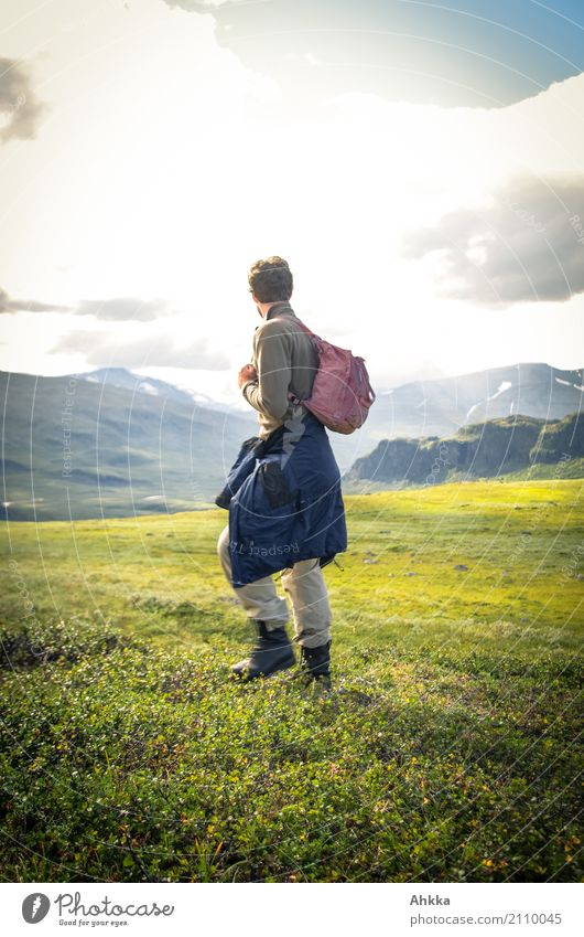 Young man in green Scandinavian mountain landscape Contentment Senses Vacation & Travel Trip Adventure Far-off places Freedom Mountain Hiking