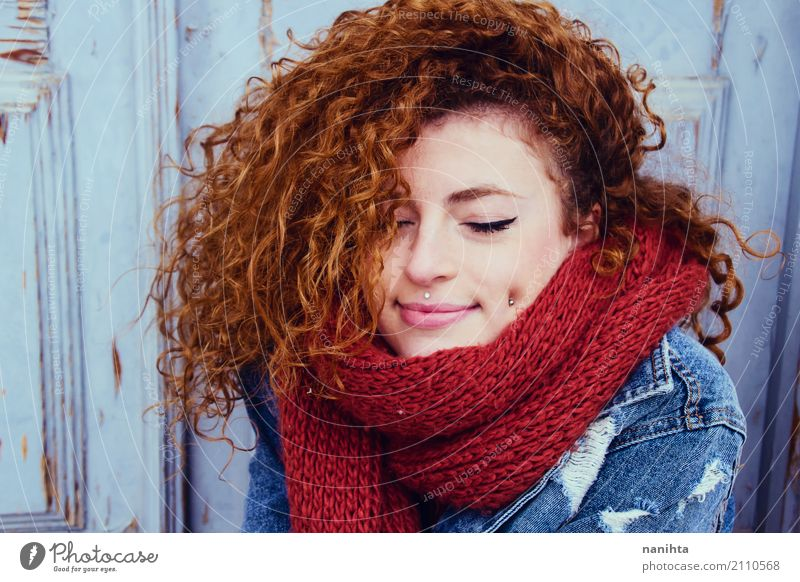 Young redhead woman wearing winter clothes Human being Youth (Young adults) Blue Young woman Beautiful Red Joy 18 - 30 years Adults Warmth Lifestyle Feminine