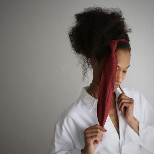 . Feminine Woman Adults 1 Human being Artist Stage play Shirt Jewellery Tie Hair and hairstyles Brunette Long-haired Curl Braids Afro Think To hold on Smiling