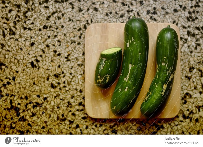 cucumbers Food Vegetable Cucumber Nutrition Organic produce Vegetarian diet Lie Delicious Healthy Eating Half 2 two and a half Wooden board terrazzo flooring