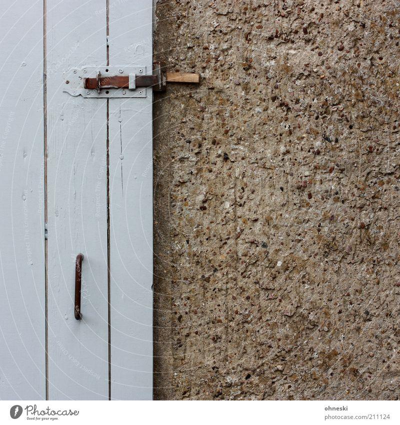 sheds Hut Building Barn Wall (barrier) Wall (building) Facade Door Gray Lock Door handle Subdued colour Exterior shot Copy Space right Detail Wooden door