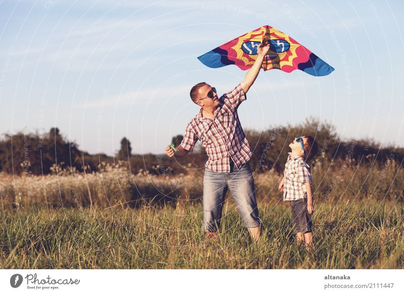 Father and son playing in the park at the sunset time. Human being Child Nature Vacation & Travel Man Summer Sun Joy Adults Street Lifestyle Sports Boy (child)
