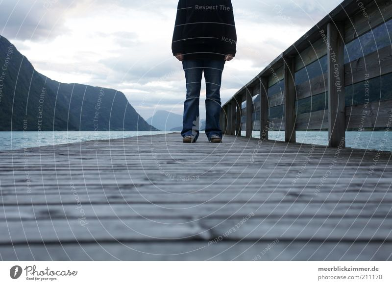 Human being Sky Water Blue Ocean Clouds Calm Cold Mountain Legs Feet Stand Handrail Footbridge Jetty Fjord