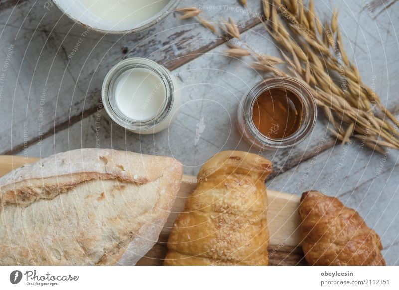 fresh bread and baked goods on wooden chopping board Eating Lifestyle Style Art Food Good Breakfast Bread Artist Lunch