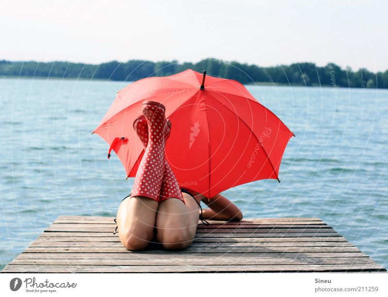 OK, I'll wait... I Woman Adults Lie Tourism Far-off places Summer vacation Feminine Sky Beautiful weather Lake Bikini Umbrella Rubber boots Observe Discover