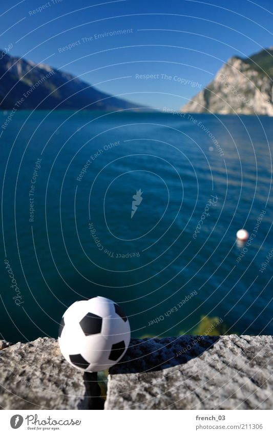 Rejection at Lake Garda Leisure and hobbies Playing Vacation & Travel Summer Mountain Sports Nature Water Cloudless sky Horizon Coast Riva del Garda Italy Blue