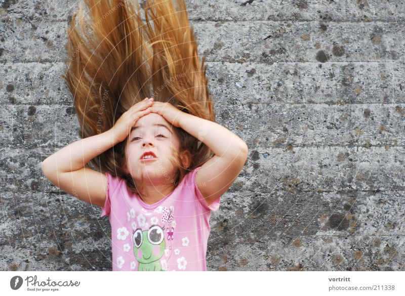 Human being Child Girl Wall (building) Gray Movement Hair and hairstyles Wall (barrier) Infancy Blonde Pink Crazy T-shirt Fantastic Brash Throw