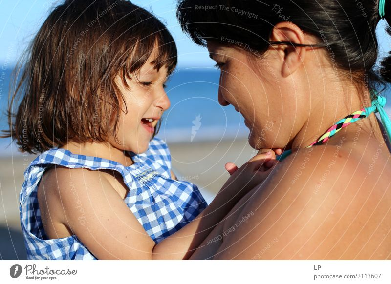 Mother and daughter laughing Well-being Leisure and hobbies Children's game Vacation & Travel Summer Summer vacation Sunbathing Beach Mother's Day Parenting