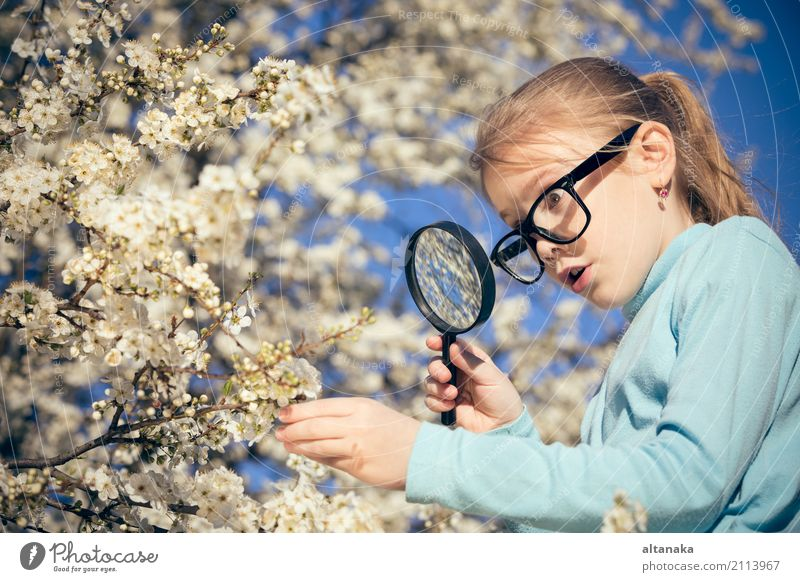 Happy little girl exploring nature with magnifying glass Human being Child Nature Summer Tree Flower Relaxation Joy Face Lifestyle Meadow Family & Relations