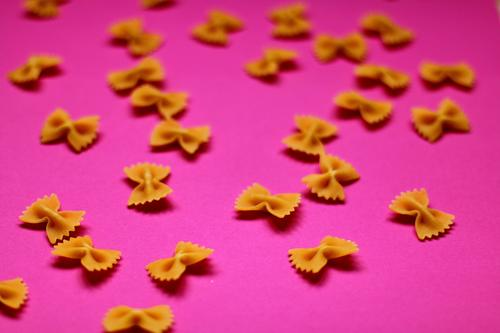pasta bows on pink backgriund Food Dough Baked goods Nutrition Eating Lunch Organic produce Vegetarian diet Diet Fasting Finger food Italian Food Lifestyle