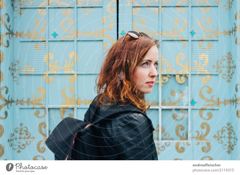 Young woman in front of turquoise painted window front Lifestyle Elegant Style Hair and hairstyles Vacation & Travel Tourism Trip Far-off places Freedom