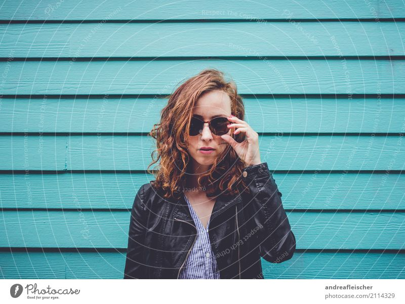 Cool young woman with sunglasses in front of turquoise wooden facade Lifestyle Vacation & Travel Tourism Trip Far-off places Freedom City trip Feminine