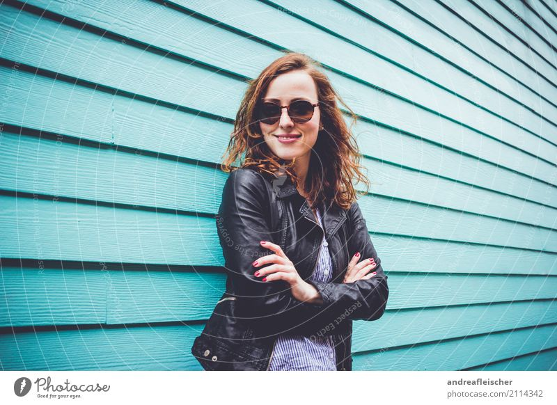 Cool young woman with sunglasses in front of turquoise wooden facade Lifestyle Feminine Young woman Youth (Young adults) 1 Human being 18 - 30 years Adults