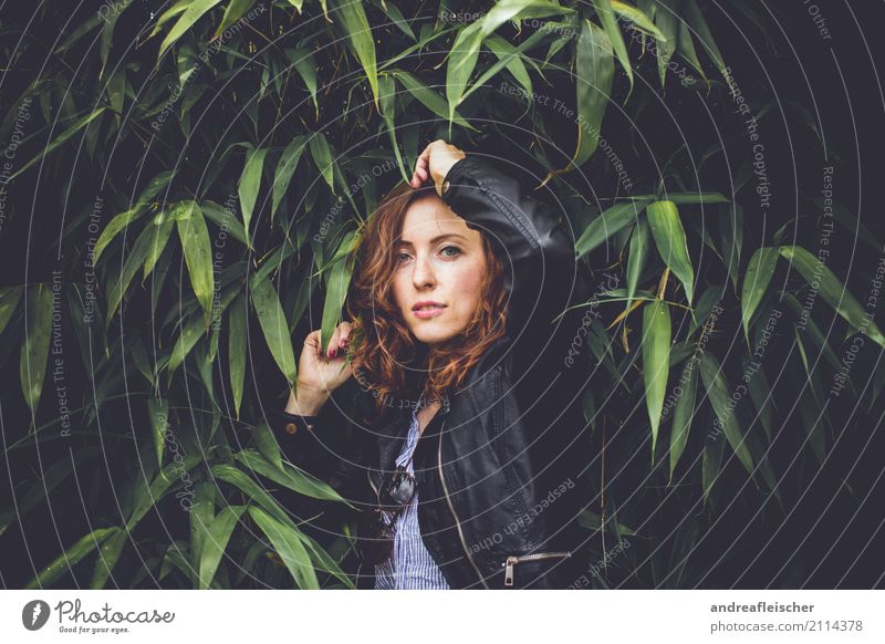 Young woman post with leather jacket in bamboo bush Lifestyle Elegant Style Joy pretty Hair and hairstyles Cosmetics Vacation & Travel Trip Summer Feminine