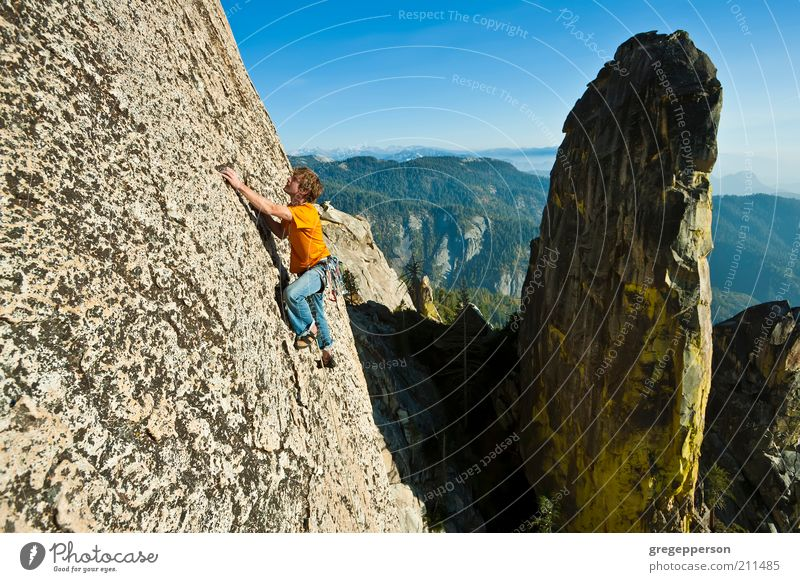 Rock climber reaching. Life Adventure Freedom Mountain Sports Fitness Sports Training Climbing Mountaineering Young man Youth (Young adults) 1 Human being