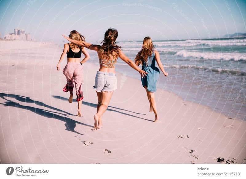 Group of girl friends running at the beach in summer Human being Vacation & Travel Youth (Young adults) Young woman Ocean Joy Beach 18 - 30 years Adults Warmth
