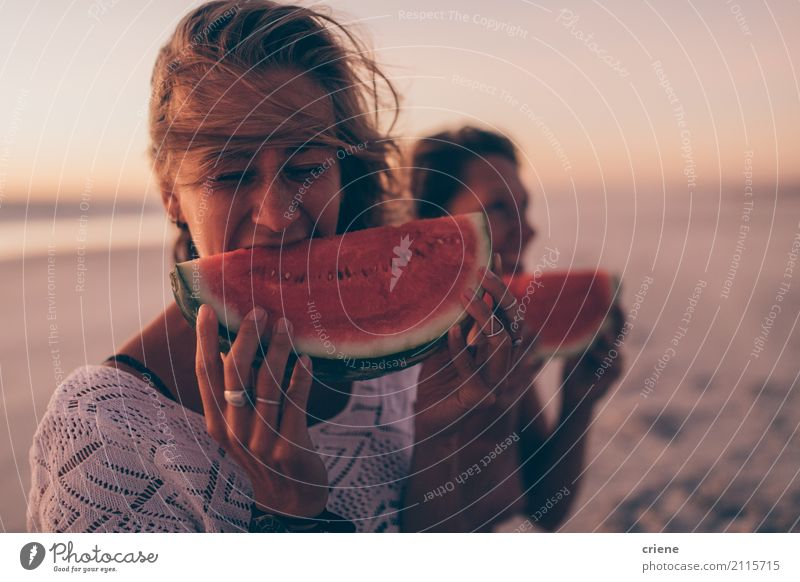 Woman eating watermelon at the beach in sunset Food Fruit Eating Lifestyle Joy Happy Healthy Eating Vacation & Travel Summer Beach Human being Feminine Adults 1