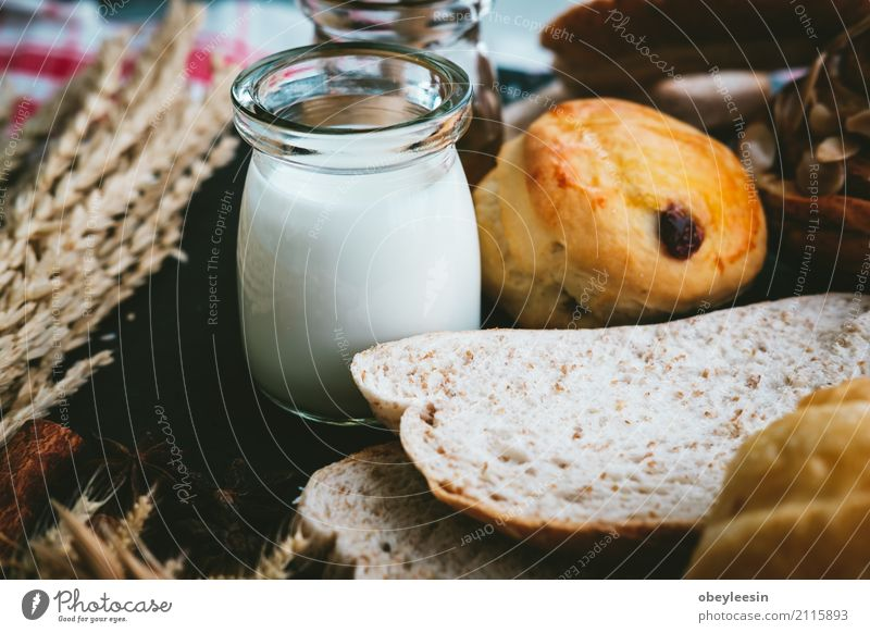 fresh bread and baked goods on wooden Dough Baked goods Bread Roll Croissant Breakfast Lunch Dinner Diet Coffee Table Kitchen Wood Fresh Natural Brown White