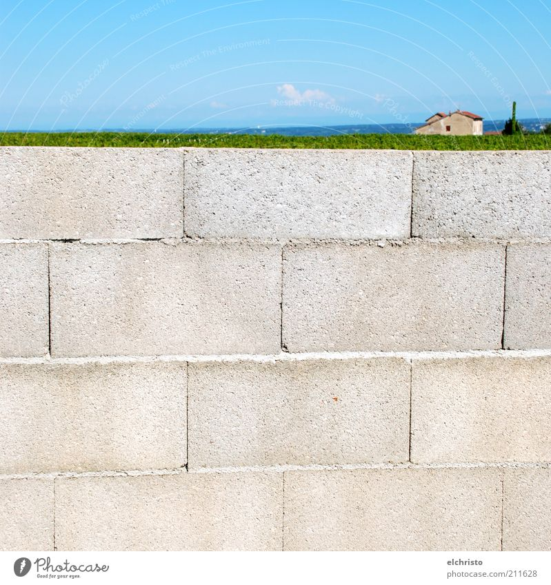 Green Blue House (Residential Structure) Far-off places Wall (building) Gray Stone Wall (barrier) Landscape Facade Perspective Beautiful weather Blue sky Structures and shapes Size difference Brick construction