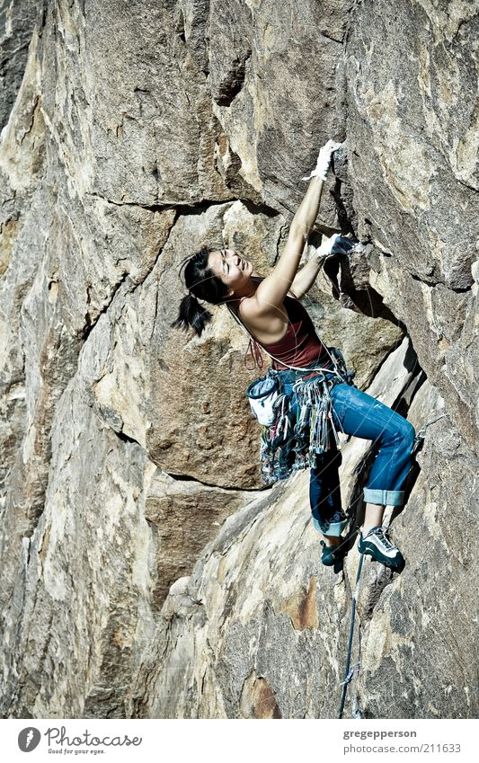 Female rock climber. Human being Youth (Young adults) Adults Life Feminine Sports Freedom Power Tall Adventure Dangerous Rope 18 - 30 years Young woman Climbing Thin